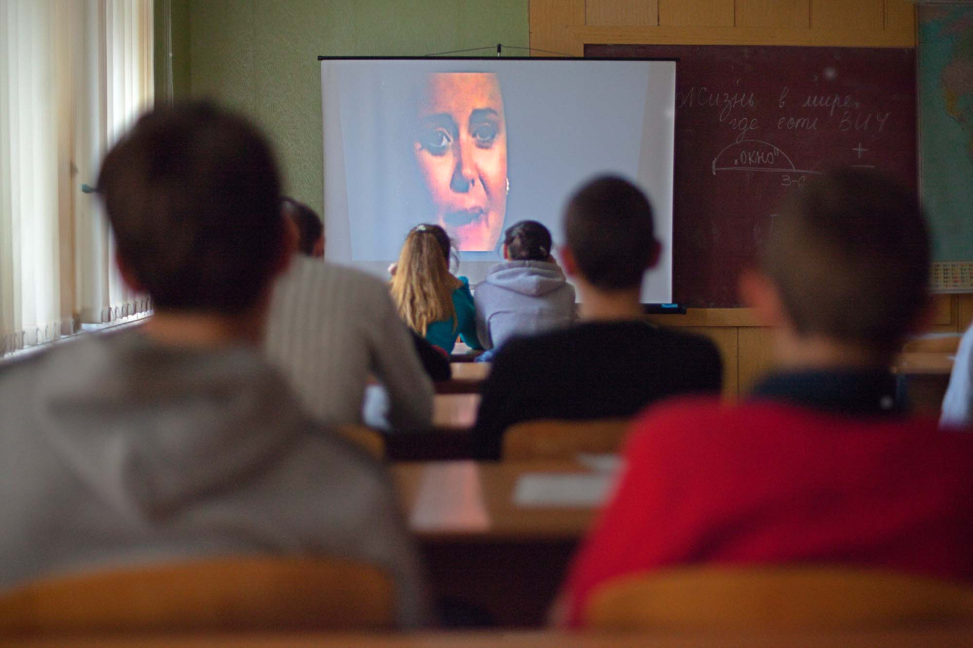 Classroom with students watching a film