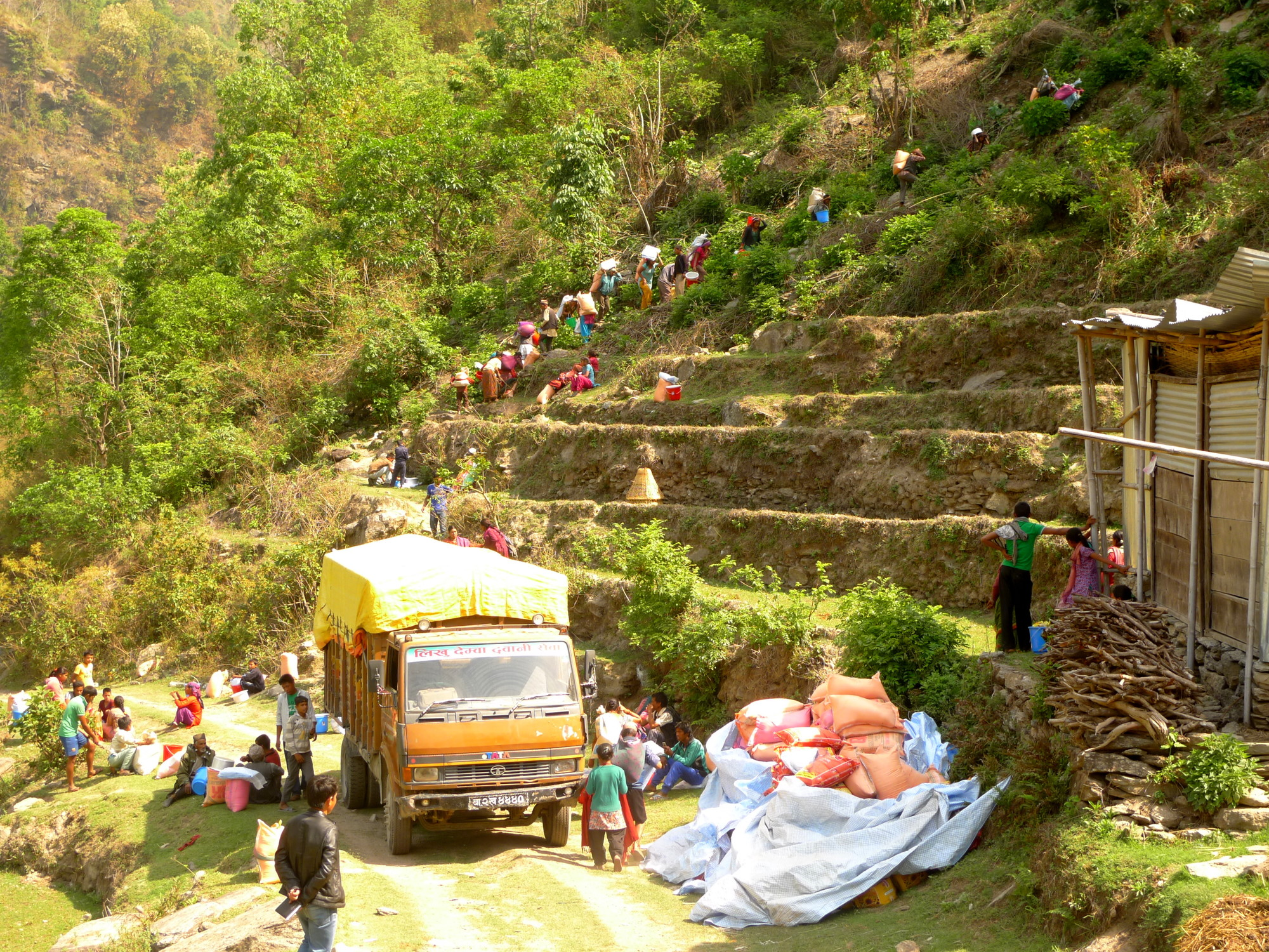 After a truck carried MCC supplies as far as it would go, Ragani villagers from Okhaldhunga District carried them home, over steep and rugged terrain. (MCC Photo/Durga Sunchiuri)