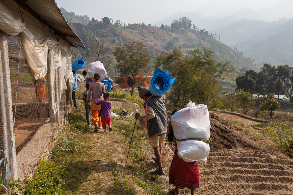 Nepalese people take winter supplies back to their village.