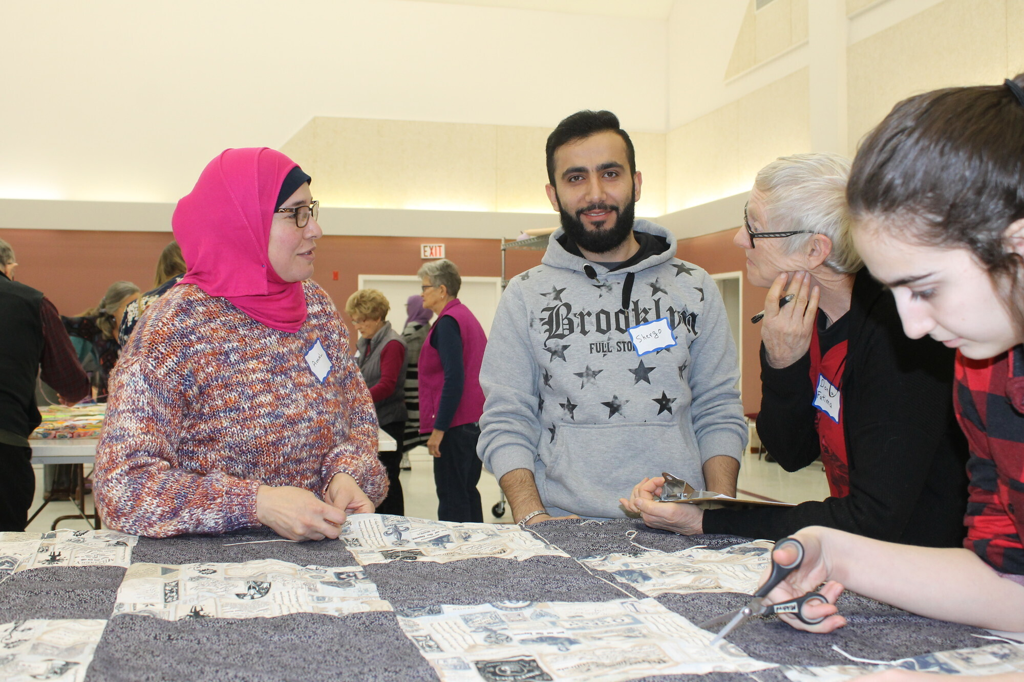 Amal Abujayyab, Shergo Ibrahim, Donna Entz and Sedra Mustafa work on a comforter together  at The Great Winter Warm-up event in Edmonton, Alta. (MCC photo/Donita Wiebe-Neufeld).