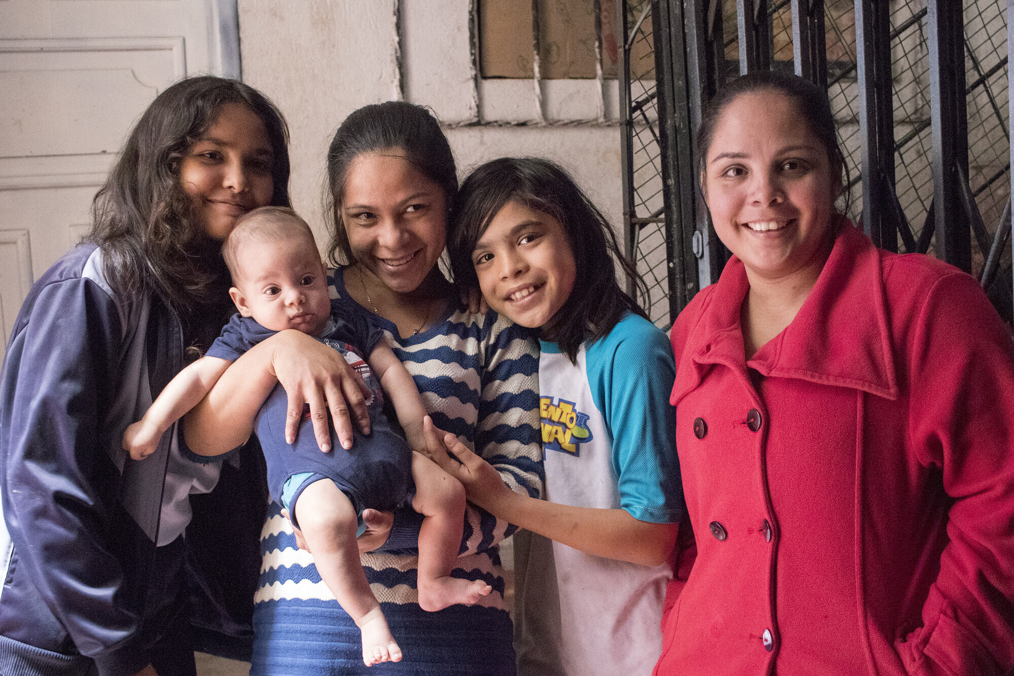 Gilchen Davalillo (centre) with her family at their new home in Quito, Ecuador. They fled the collapsing economy in Venezuela. Your donations empowered our partners in Quito to provide housing and other support. (MCC photo/Annalee Giesbrecht)