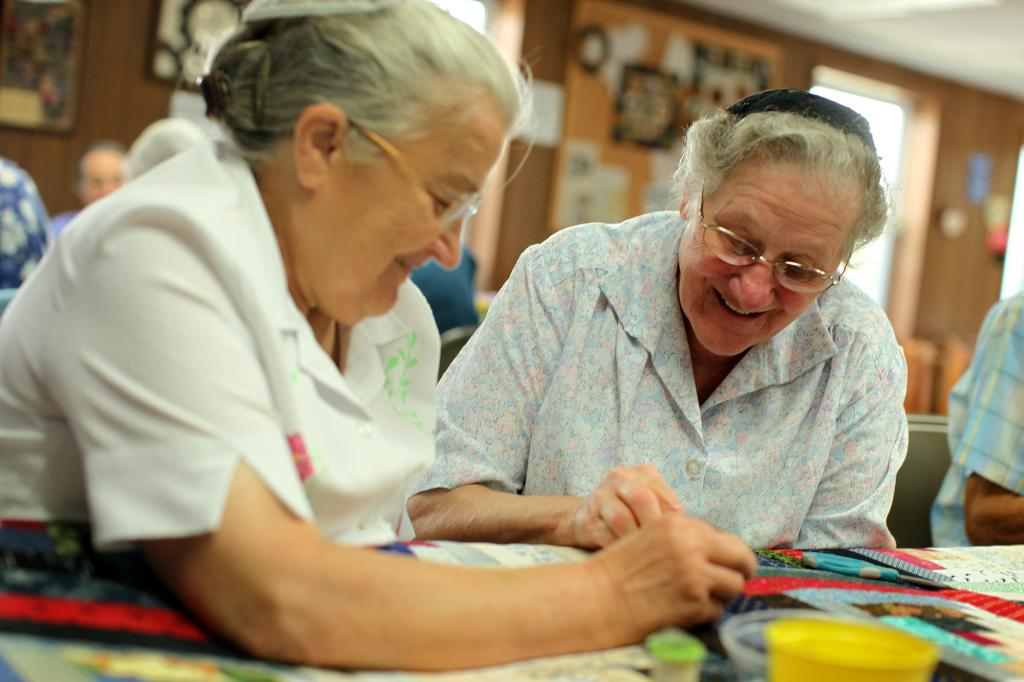 """<span class=""""photo-caption"""">Anna Stauffer (left) and Miriam Witmer (right) volunteer at the MCC Material Resources Center in Ephrata, Pa.</span><span class=""""photo-credit"""">MCC Photo by Silas Crews</span>"""