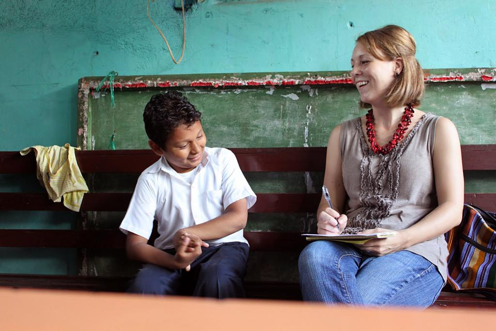 """<span class=""""photo-caption"""">Marisa Clymer Shank (right) serves as a literacy promoter in Nicaragua. She's interviewing 9-year-old Edwin Potoy Guido Francisco at Rayito del Sol school in Managua, Nicaragua.</span><span class=""""photo-credit"""">MCC Photo by Christa Marshall</span>"""