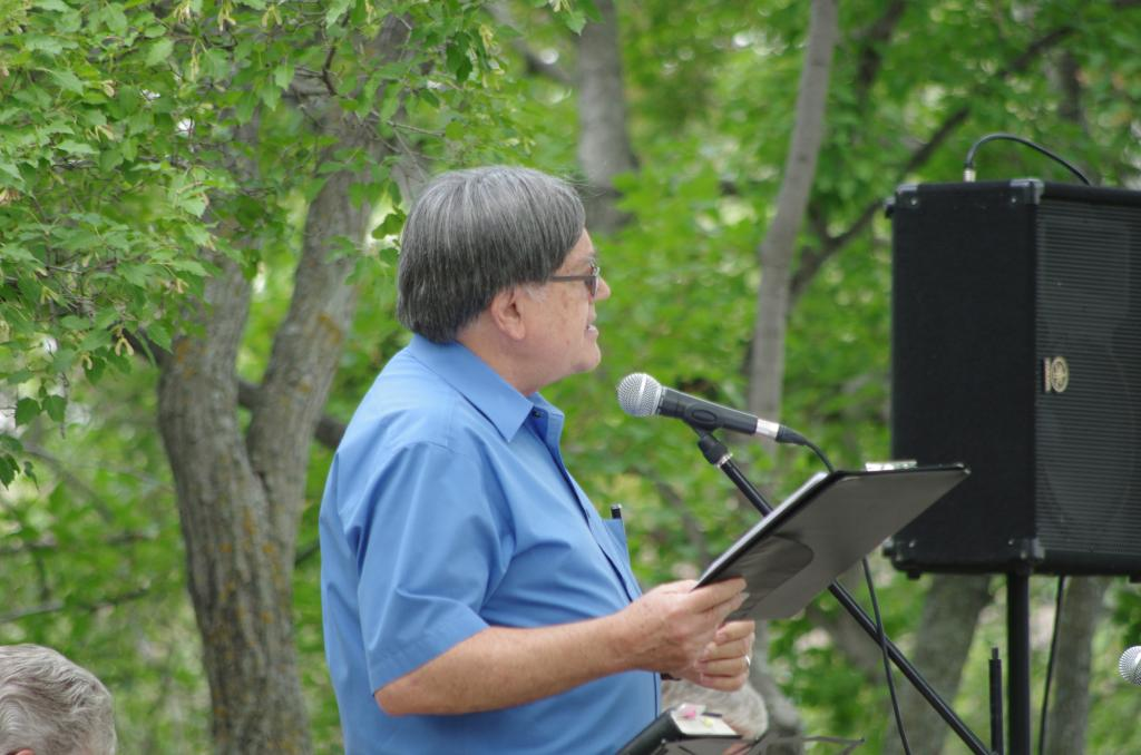 """<span class=""""photo-caption"""">Rev. David Friesen brings a message about peace to the crowd.</span><span class=""""photo-credit"""">(MCC Photo/Robb Nickel)</span>"""
