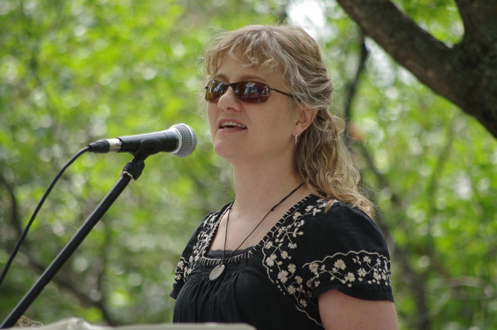 "<span class=""photo-caption"">Tina Fehr Kehler, Program Coordinator ofMCC Manitoba's Low German Mennonite Services, addresses the crowd at the 2014 Kanadiertreffen.</span><span class=""photo-credit"">(MCC Photo/Robb Nickel)</span>"