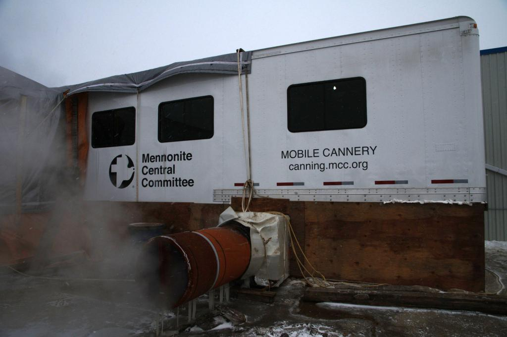 """<span class=""""photo-caption"""">Step 1: The mobile cannery arrives at the location, is unfolded and attached to a building.</span><span class=""""photo-credit"""">MCC photo by Anthony J. Siemens</span>"""