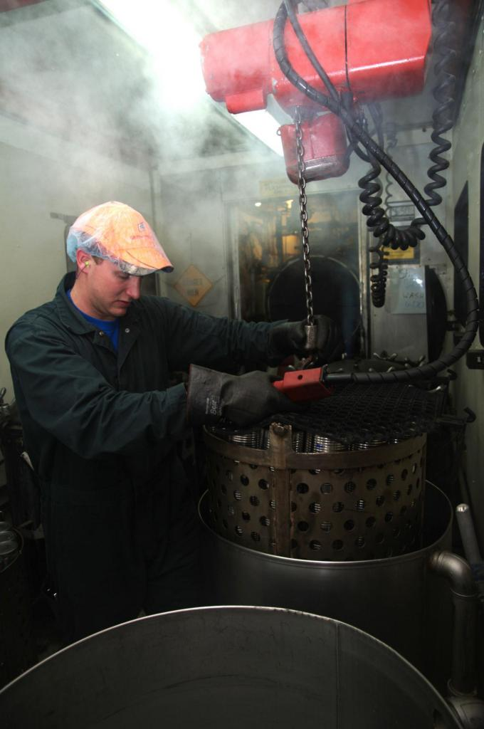 """<span class=""""photo-caption"""">Step 6: The baskets are then placed into a retort, which is a large pressure cooker, where they cook for approximately 135 minutes at 119C or246F with a pressure of approximately 15psi. After the processing is complete, the baskets are cooled using a continuous flow of water until the cans are safe to handle.</span><span class=""""photo-credit"""">MCC photo by Anthony J. Siemens</span>"""