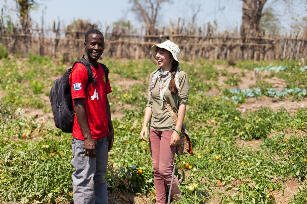 """<span class=""""photo-caption"""">Here, Rebecca and hercolleague,ChadrequeWilliamFiniasse, visita sand dam and garden plot project inMauleMaule, Mozambique. In partnership with the Christian Counsel of Mozambique, the projectsupplies 75 families with fresh water for irrigation, drinking, and washing.</span><span class=""""photo-credit"""">Matthew Sawatzky</span>"""