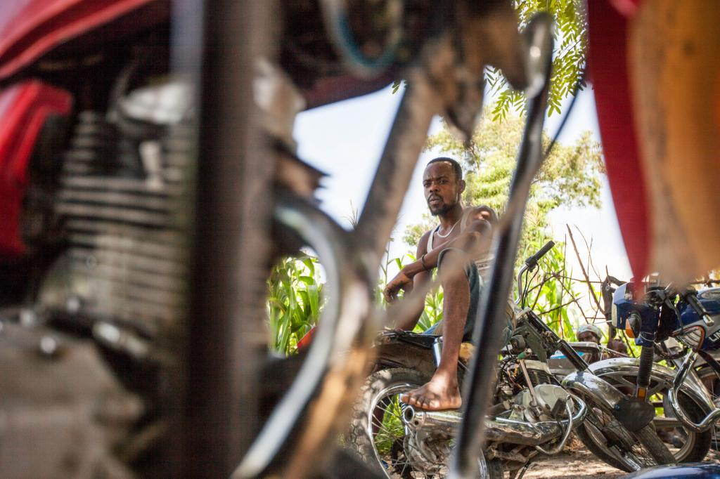 """<span class=""""photo-caption"""">In the rural Haitian town of Desarmes, 28-year-old DieunoldSterling's yard is filled with motorbikes he now has the knowledge to repair, each job a step toward his dream of establishing a full-service garage. Five years after a devastating earthquake,MCC'sHaitian partners have helped thousands of people find new opportunities in rural areas and get back on their feet in the capital city. (Learn more about Sterling and other vocational school graduates in photos 9-12).</span><span class=""""photo-credit"""">Silas Crews</span>"""