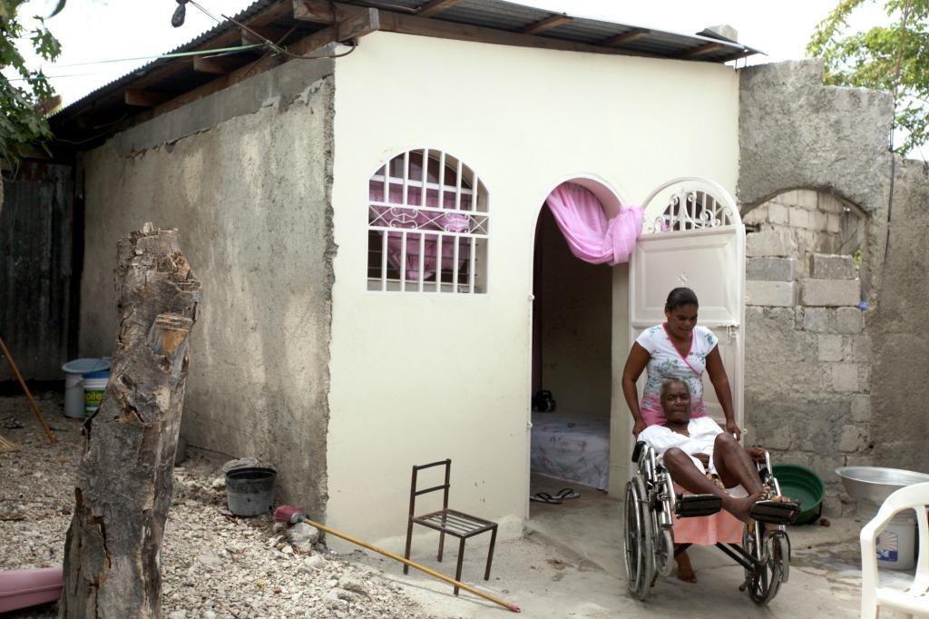 """<span class=""""photo-caption"""">Marie AntoinetteCréaExuméand daughter Nancy Marc not only had their roof replaced and new plaster put on through this project ofMCC, Church World Service and Haitian partners Christian Center for Integrated Development and ServiceChretiend'Haiti. They also got a wheelchair ramp. Today Marc can move her mother in or out of the house on her own. """"It changes everything,""""Exumésays. """"Now I'm able to go out. When it's really hot inside, I can go outside.""""</span><span class=""""photo-credit"""">Silas Crews</span>"""