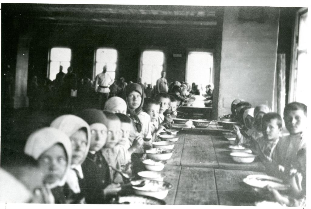 """<span class=""""photo-caption"""">Children eating at a relief kitchen in the Trans-Volga district, Russia, in 1922.</span><span class=""""photo-credit"""">Mennonite Central Committee Photograph Collection</span>"""