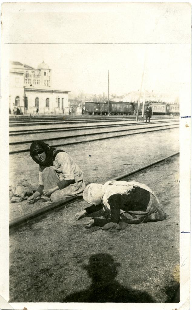 """<span class=""""photo-caption"""">Ethnic Russian mother and daughter searching for grains of wheat at the port where food from the United Stateswas unloaded in SE Crimea, Russia.</span><span class=""""photo-credit"""">Mennonite Central Committee Photograph Collection</span>"""