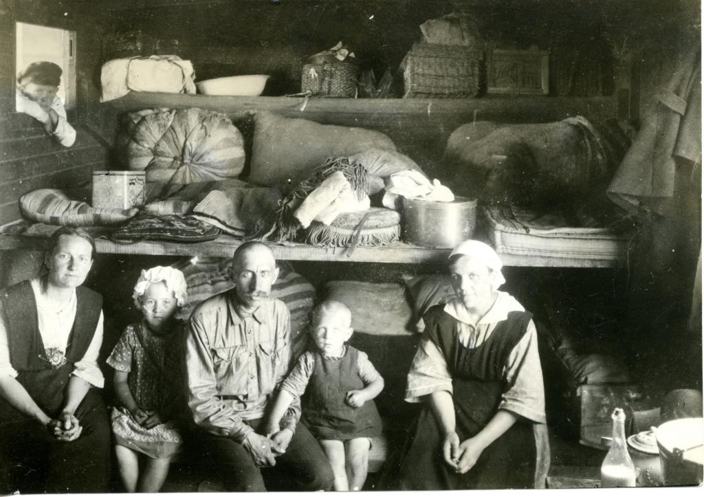 """<span class=""""photo-caption"""">Some left south Russia during these hard times, like the Shellenberg-Schonwiese family pictured here in a small room on a train. People fled to a variety of countries including Brazil, Paraguay, Mexico,Canada and the United States.</span><span class=""""photo-credit"""">Mennonite Central Committee Photograph Collection</span>"""