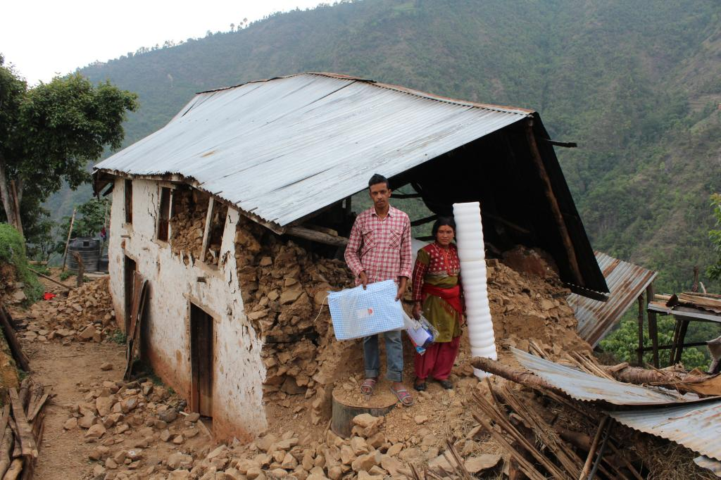 "<span class=""photo-caption"">Hari Ghimire and his wife Nirmala hold the tarp and sleeping mats they received from MCC, through RIOCD.</span><span class=""photo-credit"">MCC photo/Binod Deshar</span>"