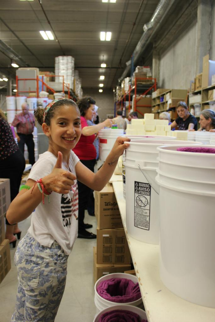 """<span class=""""photo-caption"""">Families from the local Syrian community helped assemble and pack kits for SOS Syria.</span><span class=""""photo-credit"""">MCC Photo/Josh Hissa</span>"""