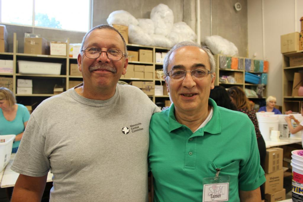 """<span class=""""photo-caption"""">MCC Ontario Materials Resources Coordinator Bob Lebold with Syrian community leader Tamer Jabbourduring the SOS Syria kit packing event.</span><span class=""""photo-credit"""">MCC Photo/Josh Hissa</span>"""