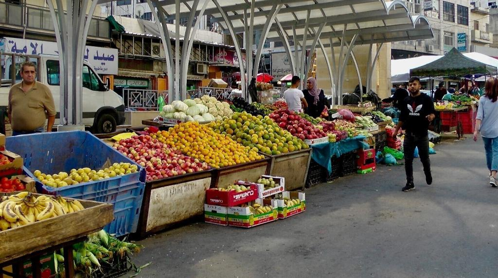 """<span class=""""photo-caption"""">The bustling Palestinian market that has been pushed to the old city limitsof Hebron. A city that is now occupied by many recent Israeli settlersand native Palestinians.</span><span class=""""photo-credit"""">Photo/Betty Enns</span>"""