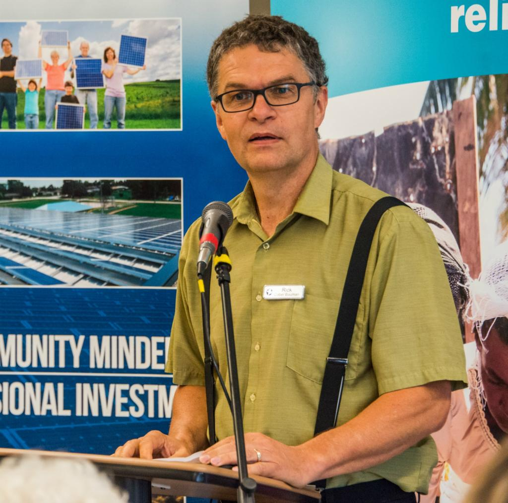 """<span class=""""photo-caption"""">MCC Ontario's Executive Director, Rick Cober Bauman, welcomes the over 300 guests who attended the Green Energy Doors Open gathering.</span><span class=""""photo-credit"""">Community Energy Development Co-op/Al Doerksen</span>"""