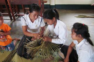 In the Tha Thom District of Laos, Mrs. Van, who goes by one name, teaches students how to make baskets as part of an MCC-supported effort to pass on traditional skills.