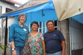 Jeanne Jantzi, left, an MCC area director for Southeast Asia, visits Naomi and Diego Petronio in the village of Tanghas during a recent trip to the Philippines.