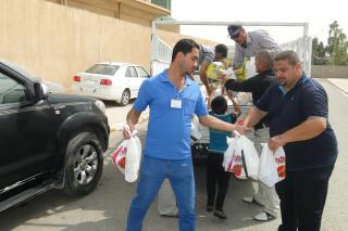 Volunteersloaded a truck with food and water in Bashiqa, Iraq with food and water to be distributed in Nineveh Province.