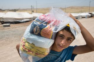 Yusuf Yahiat carries a food package