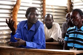 Caesaer Hakim (left) with members Michael Lagu, Agnew Masudio and Cecilia Eppe at an Opari peace committee meeting held in a school classroom.