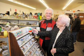 Sara Stoesz, left, and Linie Friesen, in the Altona MCC thrift shop which they helped start 40 years ago.