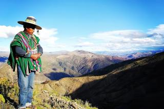 Severino Zárate Choque stands on top of a hill in Bolivia.