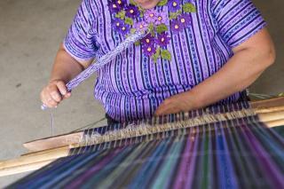 Woman weaving.