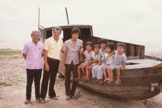 "Victor Neumann, MCC representative in Songkhla, Thailand, with ""Vietnamese boat people."" Mothers of children shown here were abducted by pirates. In response to the refugee crisis following the end of the Vietnam War, in 1979, MCC was the first agency to sign a private sponsorship agreement with the Government of Canada, leading hundreds of Mennonite and Brethren in Christ churches in Canada to resettle thousands of refugees across the country."