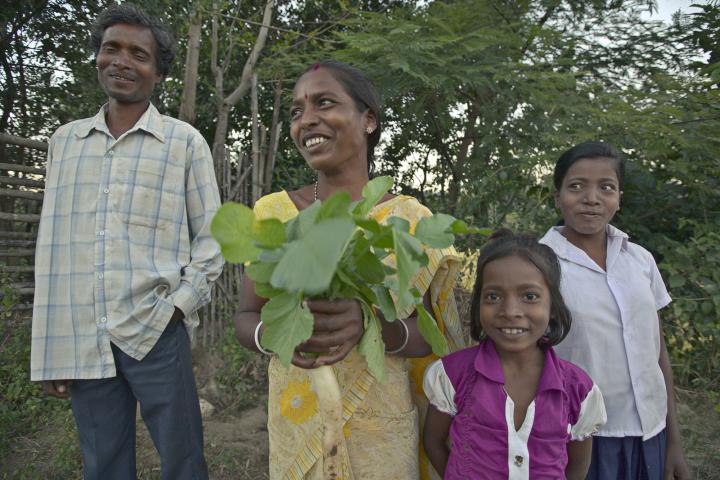 In the Ranchi district of India's Jharkhand state, Hira Mani Sanga (with husband Sunil Sanga, and daughters Sumitra, 7, and Nirmala, 14) holds radishes that she and her family grew on their land. Sanga and her family are part of an MCC-supported project of South Vihar Welfare Society for Tribals (SVWST) that includes training in kitchen gardens, horticulture and animal husbandry.