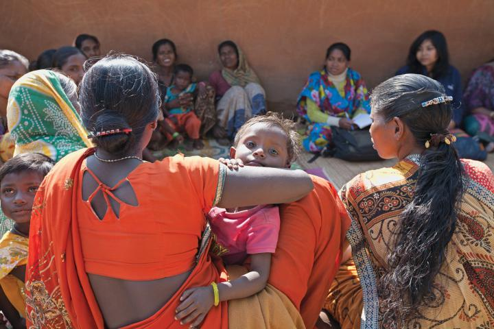 IMCC partner South Vihar Welfare Society for Tribals (SVWST) helps communities to organize themselves to share resources, work together and participate in programs such as government-funded efforts for rural development. A first step is establishing a farmers' group, women's group and youth group in each village. Sapna Tirkey and her two-year-old daughter Swati join a women's group meeting in Rurungkocha.