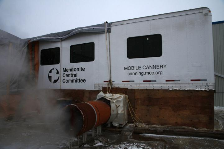 Step 1: The mobile cannery arrives at the location, is unfolded and attached to a building.