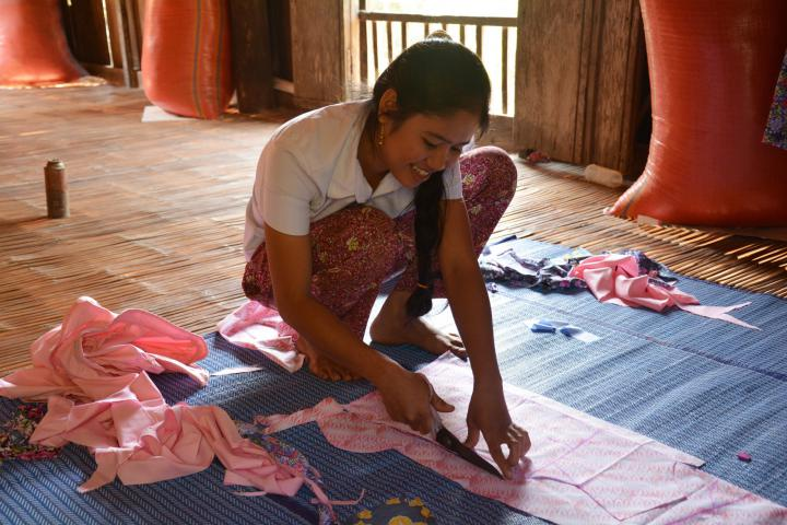 """In Cambodia's Prey Veng Province, some families send their children to work in Phnom Penh or in a neighbouring country. MCC supports sewing and tailoring programs at three rural high schools, helping students gain skills to earn a living without leaving home. ChhiChhinhis among 21 students in the program at her high school. """"I want to learn this skill for my future,"""" she says. <a href=""""http://mcccanada.ca/learn/what/education/globalfamily/reports/2014/spring/sewing-tailoring-vocational-training"""">Read more about Chhinh and her driveto start her own business.</a>"""