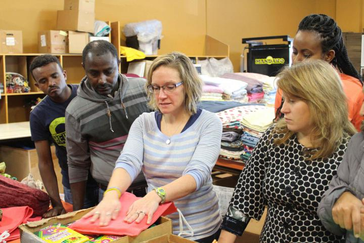 Linda Dickinson, our MR coordinator, demonstrates how to pack a school kit.