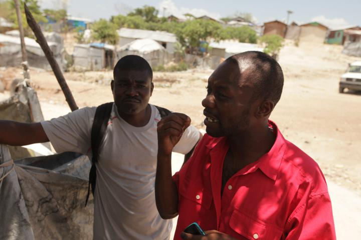 """""""What we need is houses. It's a right that we have. It's a responsibility of the state,"""" says VictorLouinel, right, who has lived in the tent camp ofCaradeuxsince 2010. By working withMCCpartnerFRAKKAand community organizer JacksonDoliscar, left, he says he's more able to speak up for his rights. """"Before, there were a lot of things people could just do to me that I wouldn't be able to respond in any way,"""" he says. (<a href=""""http://www.haitihousingdc.org/"""">More on housing issues</a>)"""