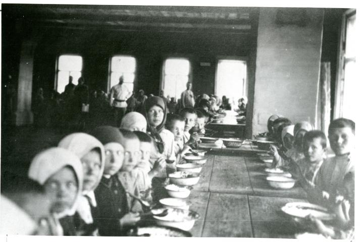 Children eating at a relief kitchen in the Trans-Volga district, Russia, in 1922.