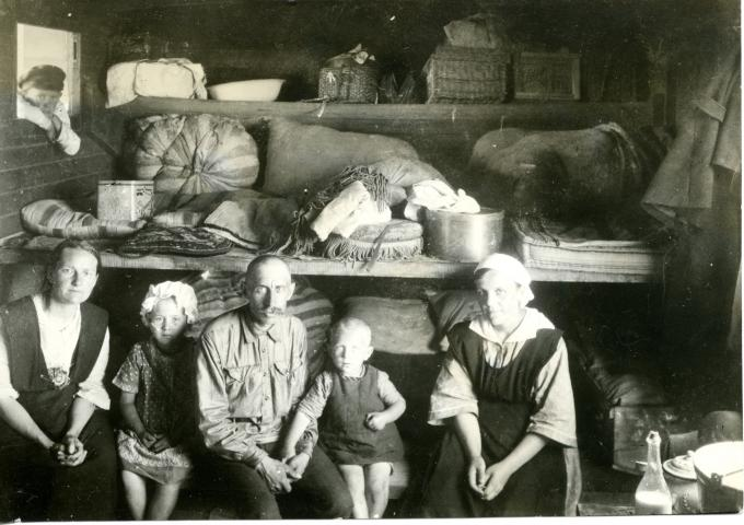 Some left south Russia during these hard times, like the Shellenberg-Schonwiese family pictured here in a small room on a train. People fled to a variety of countries including Brazil, Paraguay, Mexico, Canada and the United States.