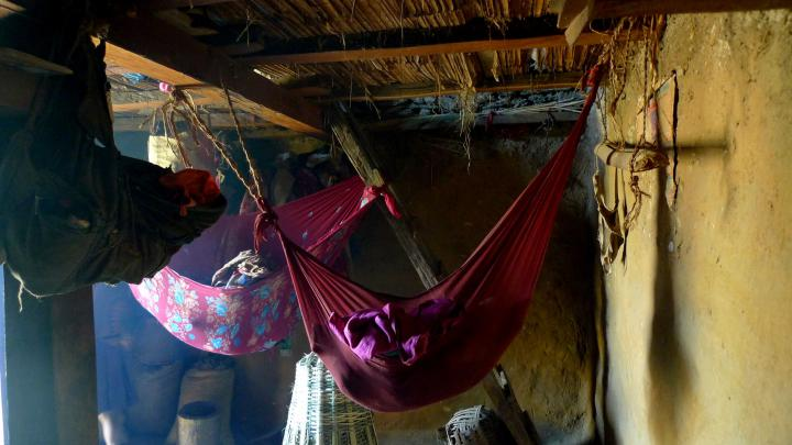 Babies sleeping through the afternoon in hammocks, Yarbang, Dhusa VDC, Dhading District. Many homes in rural villages, like this one, are made of mud, stone and timber and easily crumbled in the earthquake. According to our partners local reports say up to 90 per cent of the homes in rural areas were destroyed.