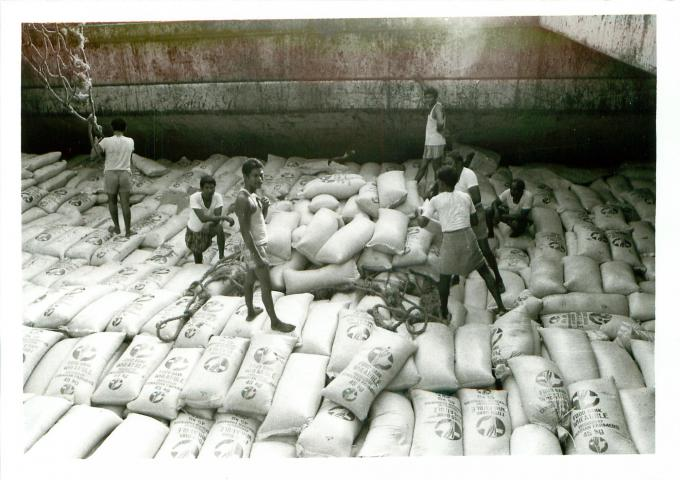 In 1976 the Ottawa Office facilitated negotiations with the Canadian International Development Agency, leading to the formation of a MCC Food Bank for emergency food assistance. In 1983 the Food Bank became the Canadian Foodgrains Bank. This photo shows Food Bank wheat being unloaded in Calcutta in 1983.