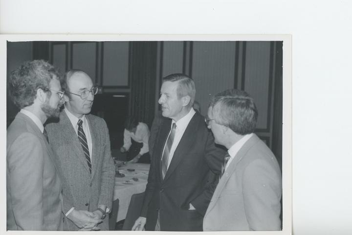 MCC staff met with Member of Parliament John Reimer after making a presentation to a parliamentary committee on Canada's aid policy in 1986.  L to R:  Stu Clark, Bill Janzen (Ottawa Office), John Reimer, and Bert Lobe.
