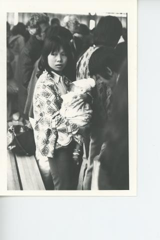 In 1979 the Ottawa Office assisted in the negotiation of Canada's first Private Sponsorship Agreement. This enabled Mennonite churches across the country to sponsor several thousand refugees from Southeast Asia over the next few years. This young woman (name unknown) and her baby arrived in Winnipeg in 1979.