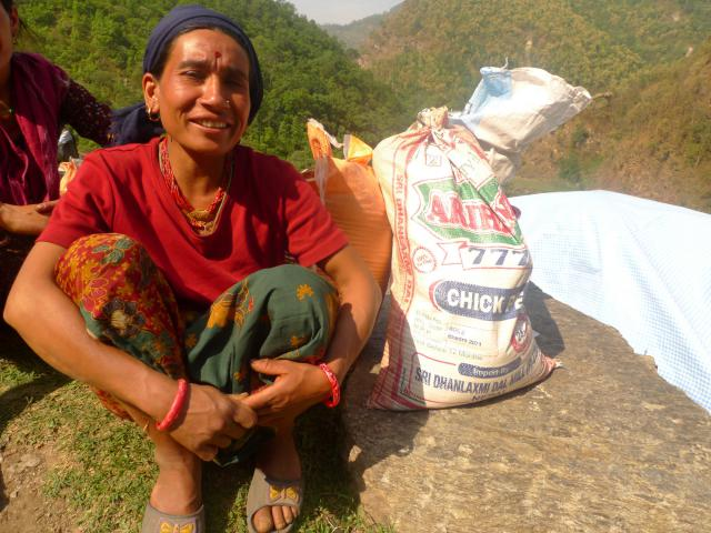 Burnamay Khatri, age 28, received relief food from MCC through local partner Group of Helping Hands in Okhaldhunga. Khatri's home was destroyed after the earthquake. She has three children.