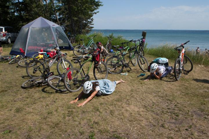 Cyclists stretch out sore muscles after the ride.