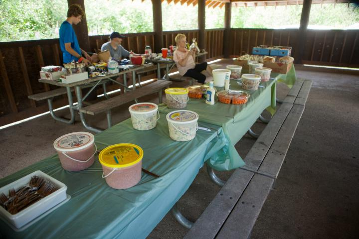 A BBQ lunch with salads and watermelon is served after the trail ride.