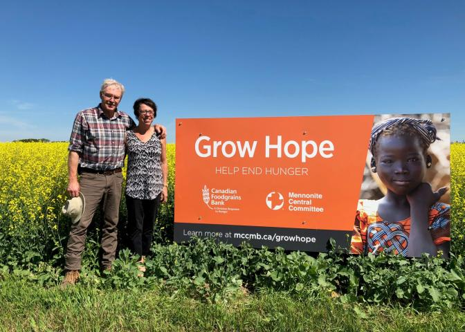 Robert and Ellen Stevenson showcase their Grow Hope canola field in mid July 2018. The Stevensonsjoined Grow Hope this year as farmers from the Rivers / Kenton area.