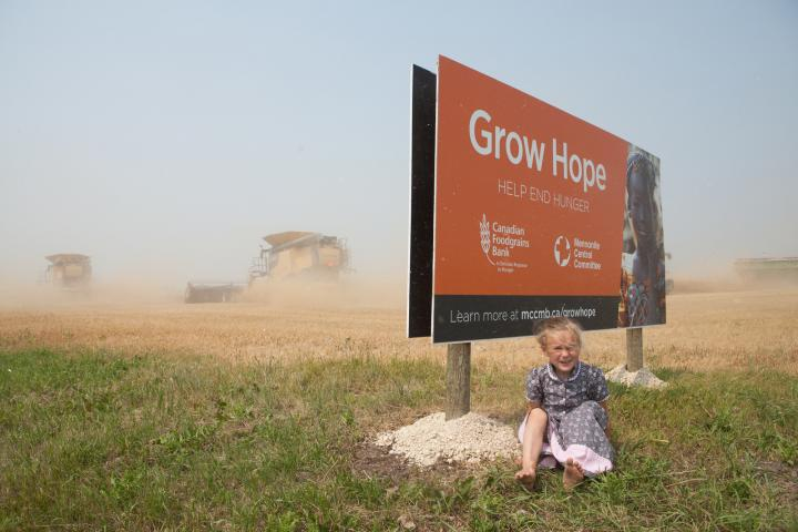 Summer Kleinsasser (5) on site at Crystal Spring's Grow Hope wheat harvest in 2018.