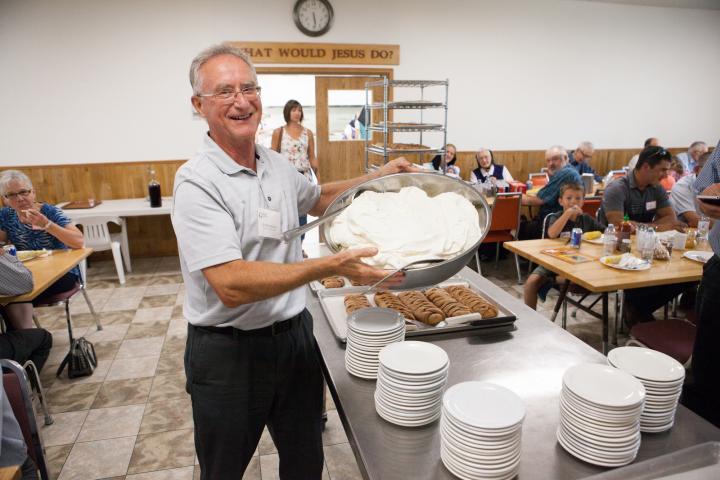 Ed Barkman, Grow Hope ambassador, showcases dessert at the 2018 harvest celebration hosted by Crystal Spring Hutterite Colony.