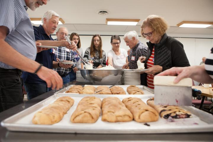 A homemade apple pastry is served as dessert at the 2018 harvest celebration at Crystal Spring Hutterite Colony.